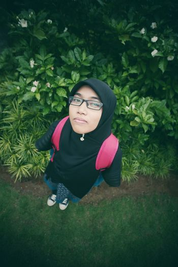 Asian woman with hijab smile at the camera fisheye lens Beautiful Woman Casual Clothing Day Eyeglasses  Front View Glasses Green Color Growth Hijab Leisure Activity Lifestyles Looking At Camera Nature One Person Outdoors Plant Portrait Real People Smiling Young Adult Young Women