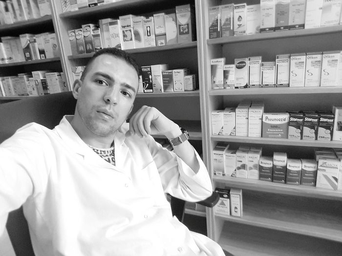 Shelf Healthcare And Medicine One Man Only Pharmacy One Person Indoors  Medicine Only Men Adult Variation Adults Only Business Finance And Industry Retail  Choice People Men Working Day Supermarket Pharmacie