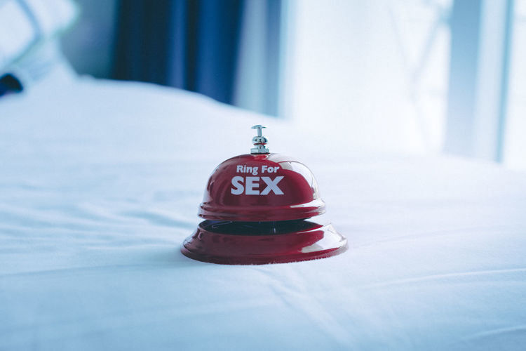 Close-Up Of Service Bell With Text On Bed