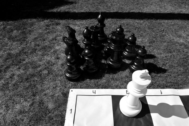 High angle view of chess pieces on floor