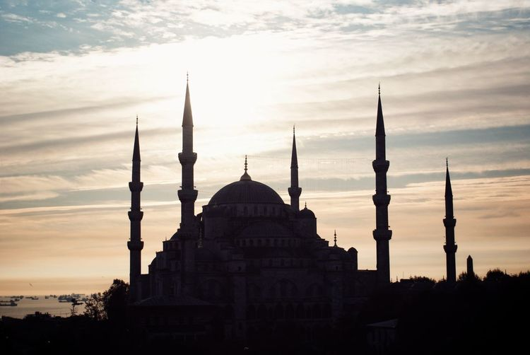 Mosque against sky during sunset