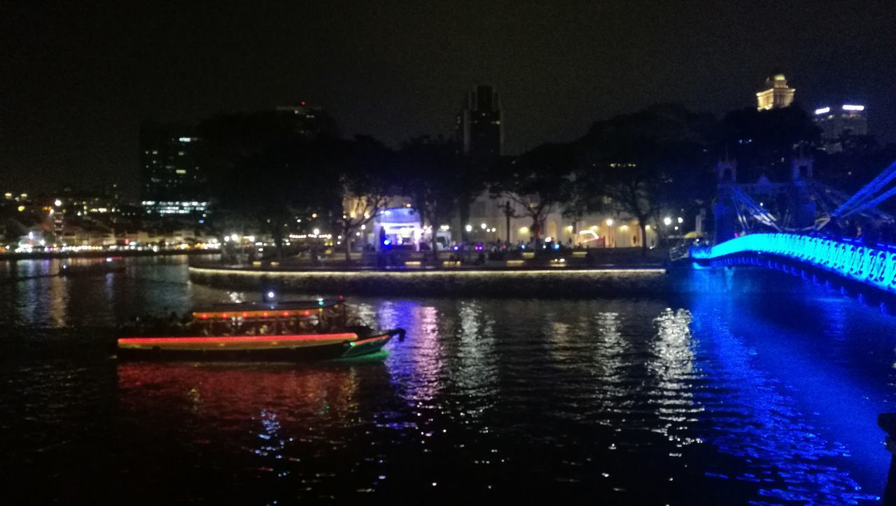 water, illuminated, night, nautical vessel, architecture, built structure, building exterior, waterfront, transportation, river, mode of transportation, city, reflection, sky, no people, nature, building, outdoors, travel destinations, light