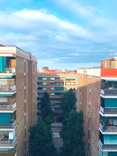 High angle view of residential buildings against sky