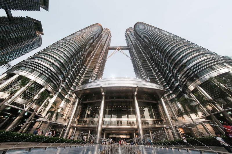 Tourist Attraction  Architecture Building City City Life Clear Sky Fish Eye Iconic Landmark Low Angle View Metallic Modern Office Building Exterior Petronas Twin Towers Shining Steel Skyscraper Steel Steel Architecture Tall - High Travel Destinations