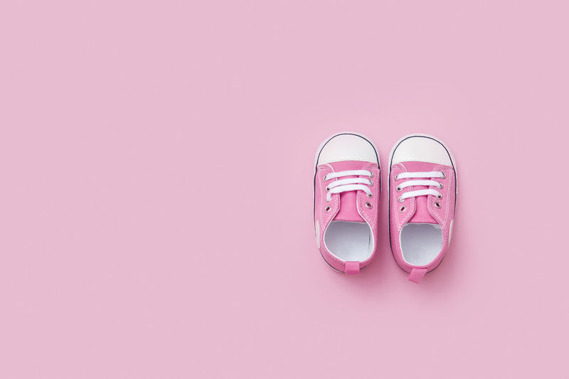 Cute pink baby girl sneakers close up on pink background Pink Pair Booties Small Baby Shoe Kid Footwear Child Fashion Girl Newborn Birthday Sneaker Sport Trendy Pastel Beauty Nobody First Sentimental Calendar Flatlay Born Childhood Family Kids Floor Top View Essential Design Collection Object Little Sneakers Month Children New Life Rubber Trainer Boot Pregnant Pregnancy Birth Space For Text Christening Happiness Miniature Motherhood Pink Color Copy Space Studio Shot Indoors  Colored Background Two Objects Still Life No People Pink Background Close-up Side By Side High Angle View Directly Above Body Part Cut Out Absence Purple Personal Accessory