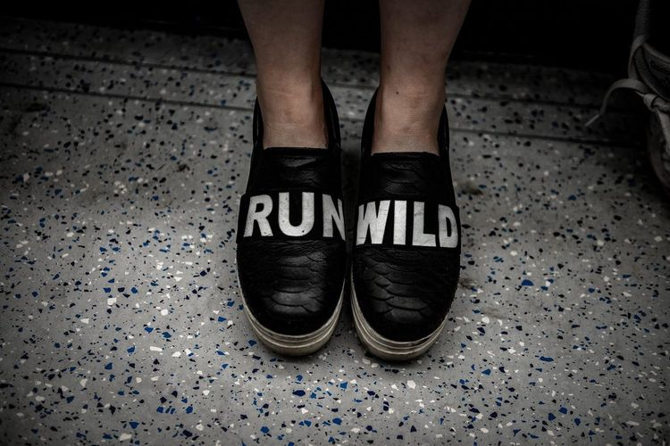 run wild Lowlight Vignette Nikon Feet Lookdown Tfl Londonunderground Footwear Text Writing RunWild Shoes Low Section Body Part Human Body Part One Person Human Limb