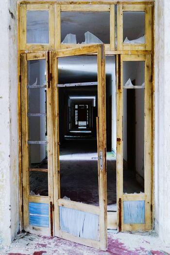 Broken Glass Door Of Abandoned House
