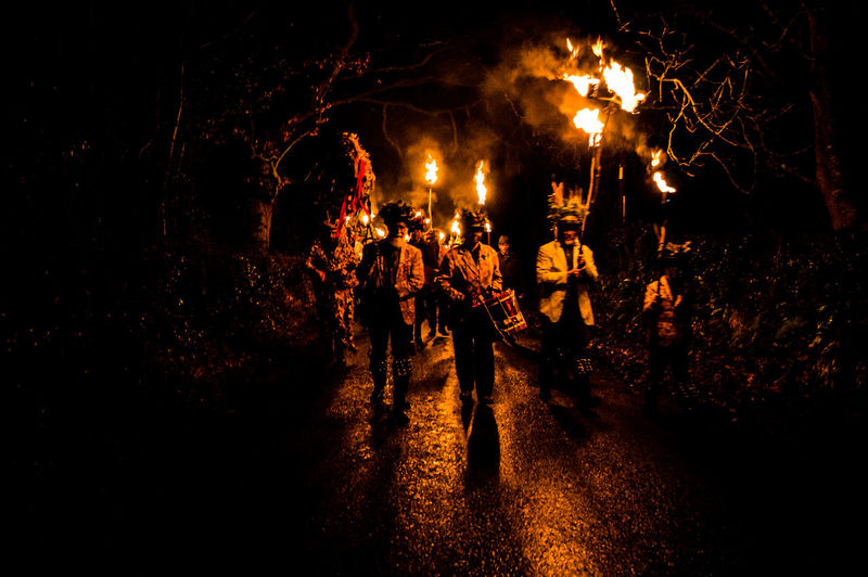 Eardisley, Herefordshire, UK. 6/7/2017. Members of the Leominster Morris folk dance group take part in a Mummers Play and torch lit Wassailing ceremony on the Epiphany, also widely known as Three Kings Day, or even Dia de los Tres Reyes Magos. The Christian holiday is typically celebrated 12 days after the Christmas in the Gregorian calendar, and serves, traditionally, to commemorate the baptism of Jesus. The holiday was also associated with the three kings' visit to the Christ child. Epiphany is used to describe the final day of the 12-day Christmas celebrations, as well as the season of Epiphany. Epiphany is celebrated globally within the Roman Catholic, Protestant and Eastern Orthodox faiths. Countries, from Mexico and Switzerland to Germany and Spain, observe the religious holiday. Adult Celebration Cultures Eardisley Folk Dancers Herefordshire Illuminated Leominster Morris Men Morris Men Night Outdoors People Real People Togetherness