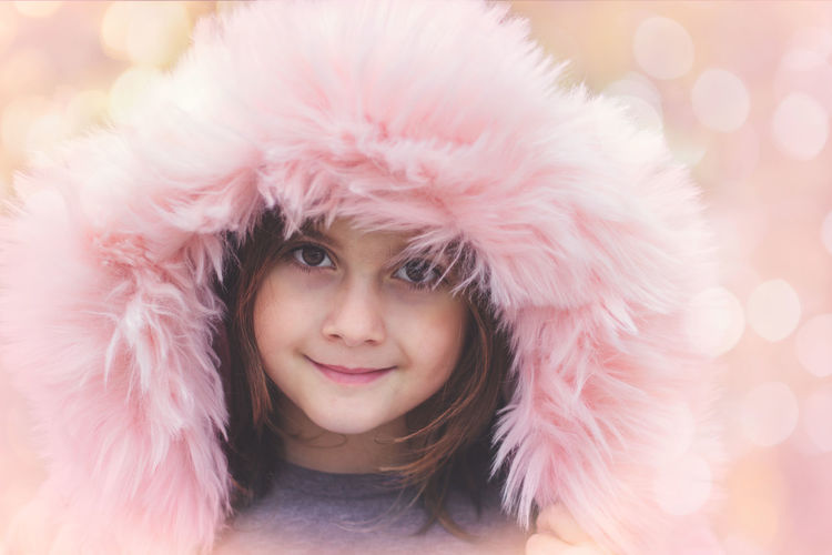 Little girl with pink fur portrait The Portraitist - 2018 EyeEm Awards Bokeh Clothing Emotion Front View Fur Fur Hat Girl Girls Happiness Hat Headshot Human Face Innocence Looking At Camera One Person Pink Color Portrait Smiling Winter