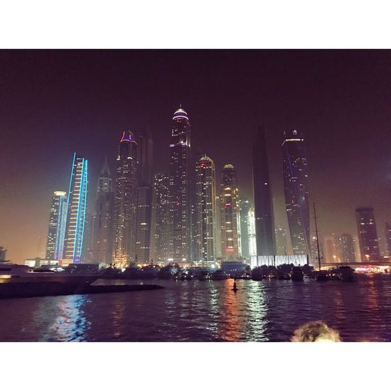 Building Exterior Built Structure Architecture Illuminated Night Water Waterfront Skyscraper Travel Destinations Clear Sky Sea Sky Outdoors City No People Modern Cityscape Leisure Activity Dubai EyeEmNewHere