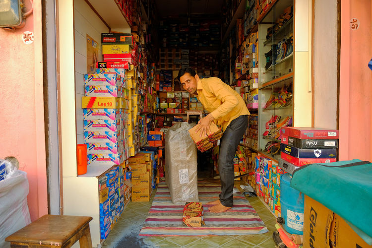 Daily life of streen market in Mandawa, India. Mandawa, Rajasthan Adult Casual Clothing Day Front View Full Length Furniture Indoors  Leisure Activity Lifestyles Males  Mandawa Men Mid Adult Multi Colored One Person Real People Retail  Sitting Young Adult Young Men