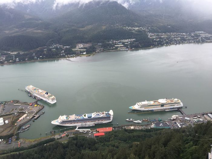 Three cruise ships in Juneau Juneau Mountain View Norwegian Cruise Line Norwegian Jewel Radiance Of The Seas Royal Caribbean Cruise Star Princess Alaska High Angle View Mode Of Transport Mountain Nautical Vessel Princess Cruises Sea Transportation View From Above Water