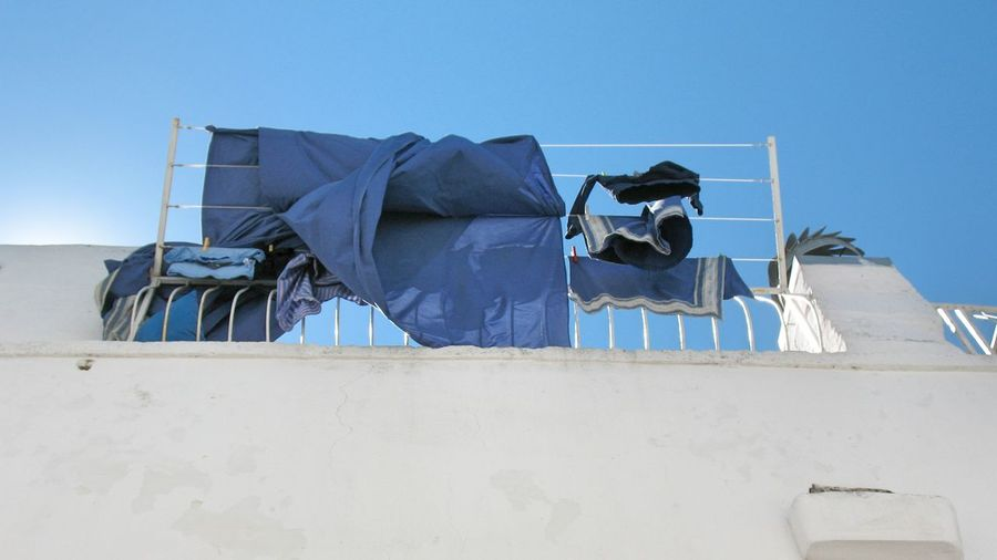 Low Angle View Of Fabrics On Building Terrace