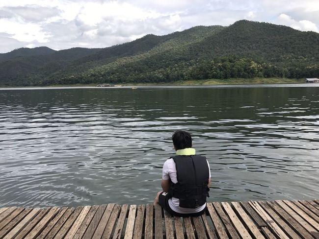 คนเหม่อลอย Lake Rear View One Person Water Mountain Sitting Cloud - Sky Real People Nature Outdoors Day Mountain Range Leisure Activity Men Relaxation Lifestyles Adults Only Adult One Man Only Vacations MaeTang