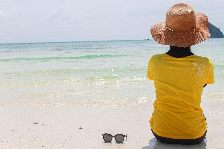 Alone Alone Time Krabi Thailand Beach Beauty In Nature Clothing Day Hat Horizon Horizon Over Water Land Leisure Activity Lifestyles Nature One Person Outdoors Real People Rear View Scenics - Nature Sea Sky Sun Hat Water