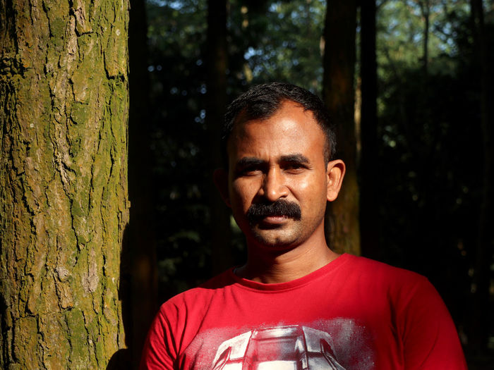 Portrait of man in forest