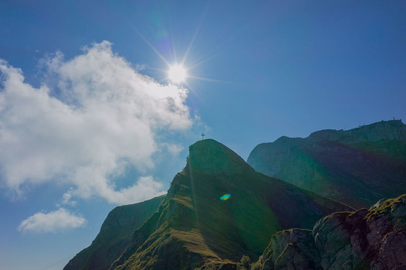 Low angle view of mountain against sky on sunny day