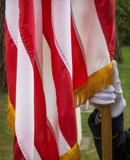 American Flag on Memorial Day Anerican Flag Close-up Day Glove Hands, Memorial Day Men Military Military Uniform One Person Outdoors People Real People Red Soldier Uniform