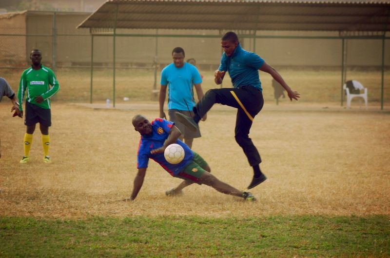 Flight to finish Athlete Ball Competitive Sport Defending Dribbling Football Kicking Lifestyles Match - Sport Men Only Men Outdoors People Playing Scoring A Goal Soccer Soccer Ball Soccer Field Soccer Player Sport Sports Clothing Sports Training Sportsman Young Adult