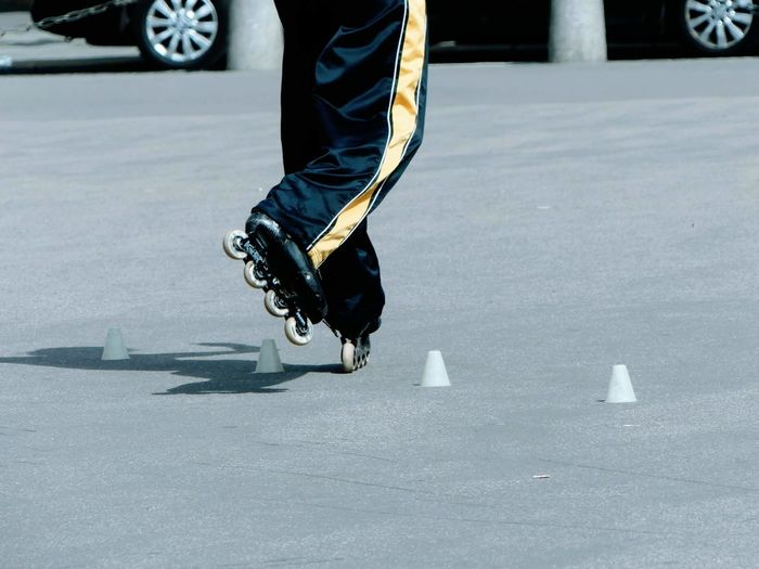 Low section of person skating on road