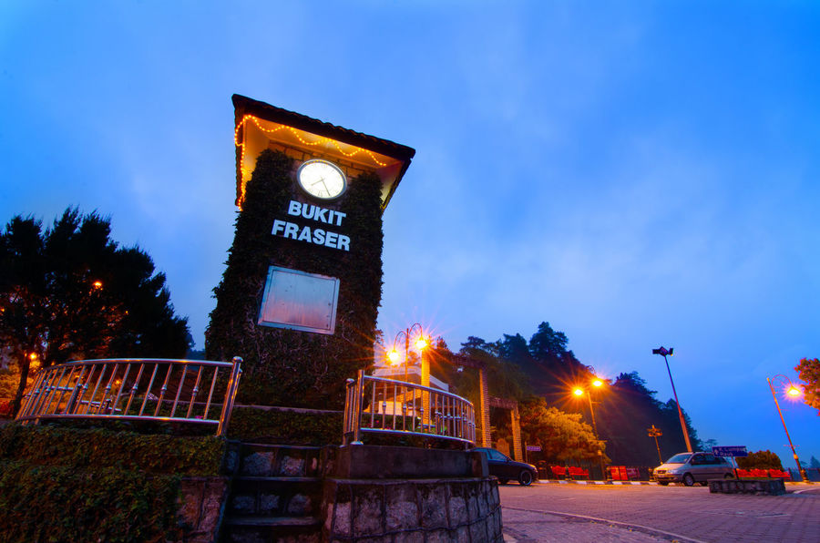 Fraser Hill Architecture Building Exterior Built Structure City Communication Dusk Illuminated Low Angle View Motor Vehicle Nature Night No People Outdoors Plant Sign Sky Street Street Light Text Transportation Tree
