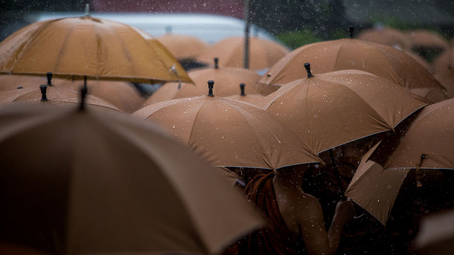High angle view of brown umbrellas during rainfall