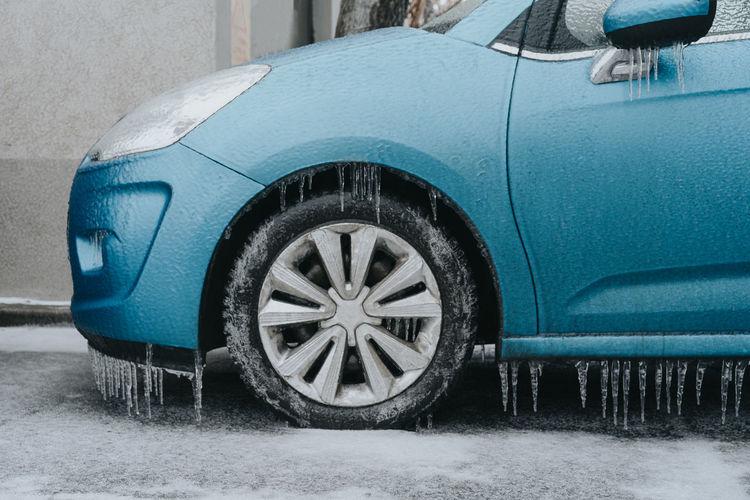 Freezing Rain Icicle Blue Tire Car Close-up Parking Lot Stationary Vehicle