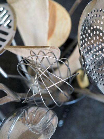Close-up of kitchen utensils in container