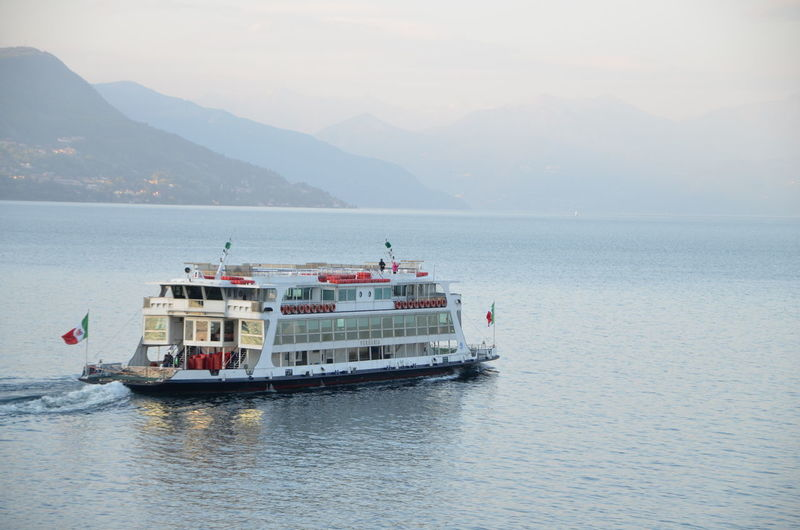 Scenic view of ferry on lake against sky