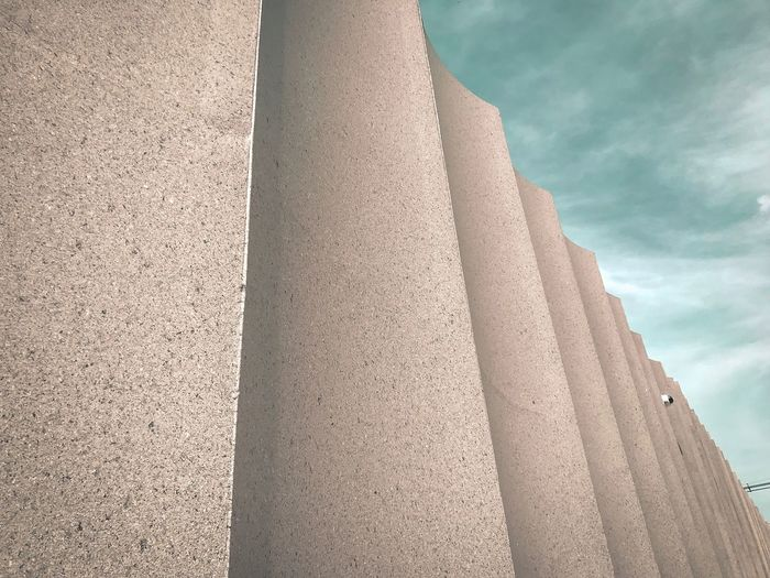 Low angle view of concrete structure against sky