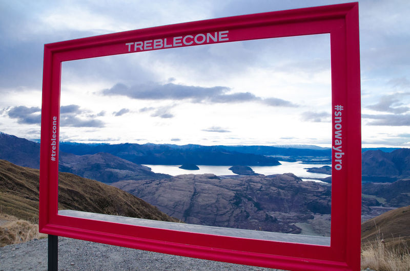 The red photo frame on the hill at Treble Cone ski resort for tourist to stay in the frame with the view in background and capture at Wanaka, South Island, New Zealand. Beautiful Cloudy Dark Low Light Mountians Nature Square Tourist Attraction  Traveling Trip Winter Cold Temperature Destination Lakkee Landscape Mountain Range New Zealand No People Outdoors Popular Red Frame Season  Sky South Island Treble Cone Ski Resort