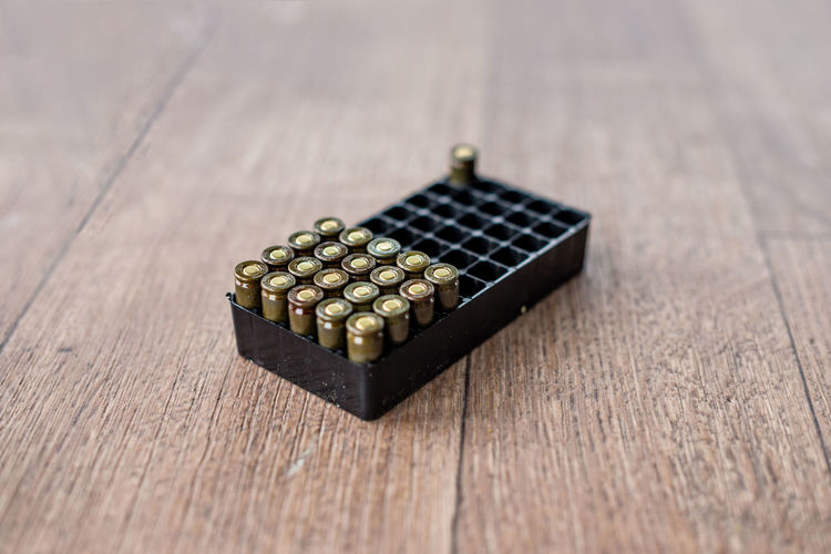 Close-Up Of Ammunitions In Box On Table