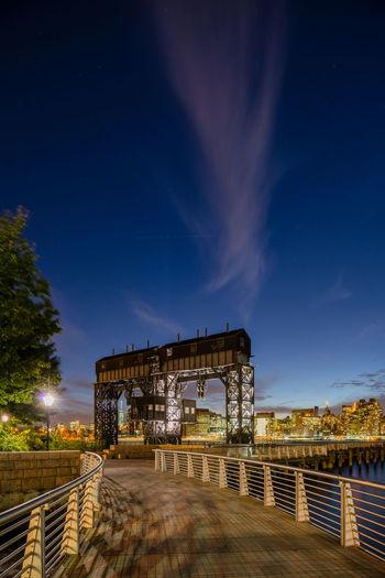 Illuminated Built Structure Against Blue Sky