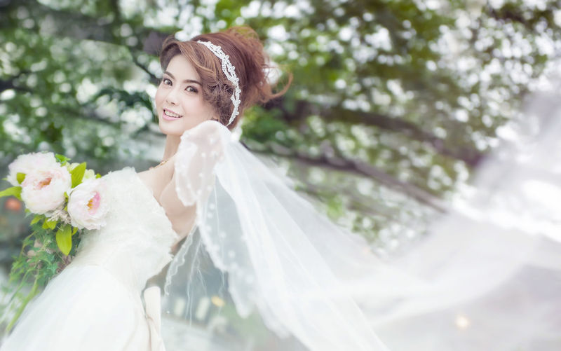 Adult Beautiful People Beautiful Woman Beauty Bouquet Bride Celebration Cheerful Flower Happiness Holding Life Events Married One Person One Young Woman Only Smiling Veil Wedding Wedding Ceremony Wedding Dress White Color Wife Women Young Adult Young Women