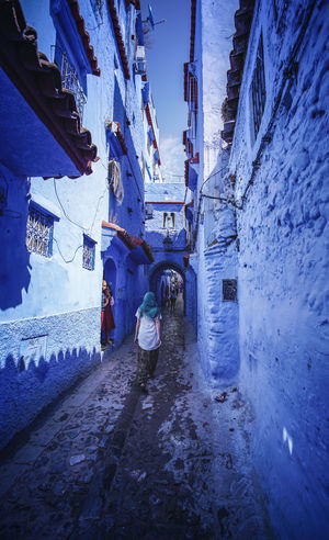 """The Blue City"" - Chefchaouen, Morocco. Chefchaouen Chefchaouen Medina Medina Morocco MoroccoTrip EyeEmNewHere a new beginning Digital Nomad Travel Travel Destinations Traveling Travel Photography Photography Blue City Alley Maze Arabic Moroccans Tourism Tourist Attraction  Tourist Destination Architecture Built Structure Building Exterior Real People Day Building Winter Full Length Cold Temperature Walking Snow Men The Way Forward People Nature Direction Residential District Outdoors"