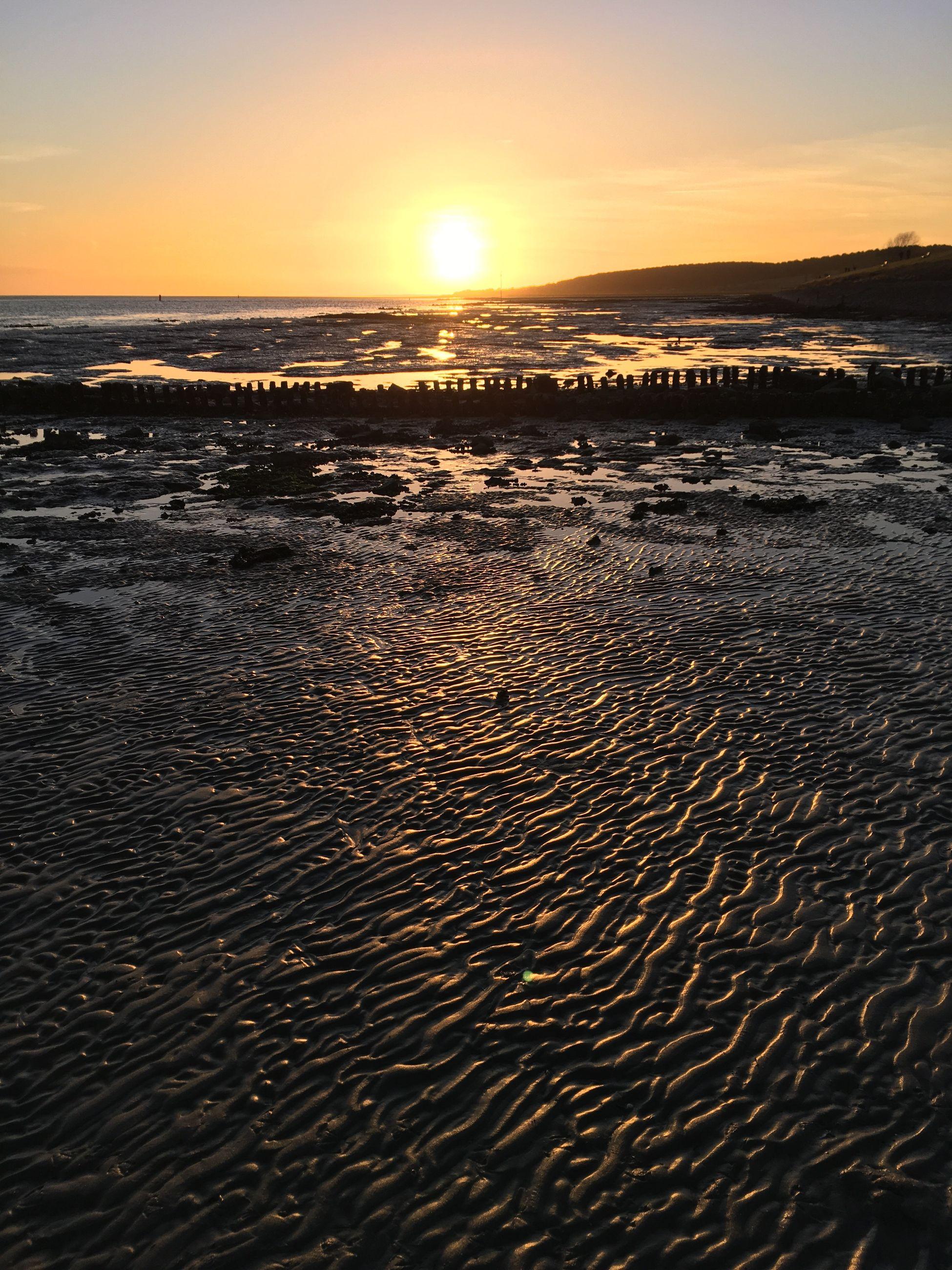 sunset, sky, beauty in nature, scenics - nature, water, land, tranquility, sea, beach, orange color, tranquil scene, nature, idyllic, horizon, sand, sunlight, non-urban scene, no people, horizon over water, sun, outdoors, low tide
