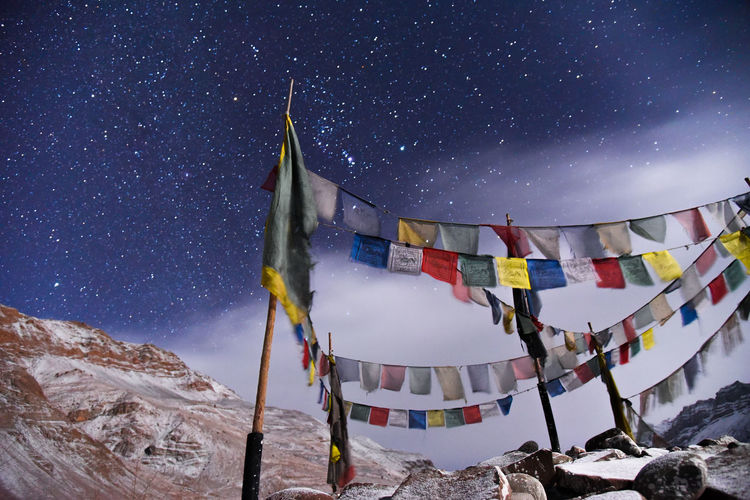 Panoramic view of traditional buddhist prayer flags against sky at night