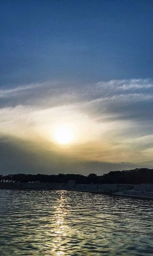 Sunset is my favourite colour and simply i love people who view sunset with wonder. Took the shot. Popular Togetherness Neighbourhood Sunset Beauty In Nature Sky Water Nature Eyem Diversity Check This Out Resist! Hello World You Raise Me Up✨ Looking At Camera We Are Photography, We Are EyeEm
