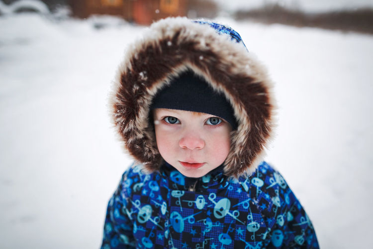 Portrait of cute boy in snow