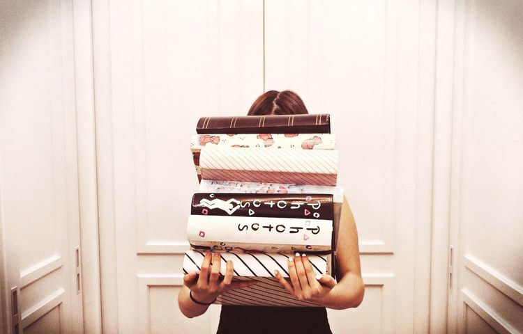 Photographic Memory At Home Live, Love, Laugh EyeEm Gallery Door Young Women Album Books Emotions Laughing Picturing Individuality Portrait Woman Paper Vintage Memories Vignette Arm Pastel Power Interior Views