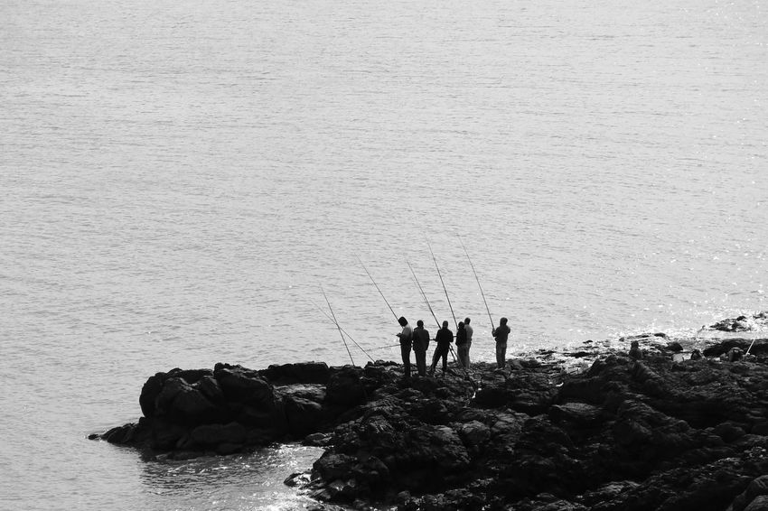 Fishing Fishing Time Fisherman Fishermen Silhouette Silhouettes Waterfront Life Is A Beach Traveling Travel Travel Photography Blackandwhite Black And White Black & White Monochrome Rock Formation Rocks And Water Rock Uruguay Eyeemphoto Punta Del Este Sunset_collection Beach This Is Masculinity