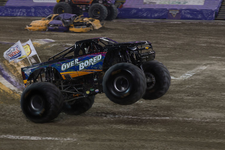 Jump Monster Jam Monster Trucks Auto Racing Close-up Competition Day Land Vehicle Motorsport No People Outdoors Racecar Sports Race Sports Track Tire Transportation Truck Trucks