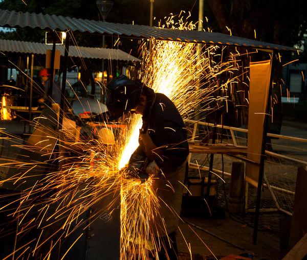 Man working on metal in factory