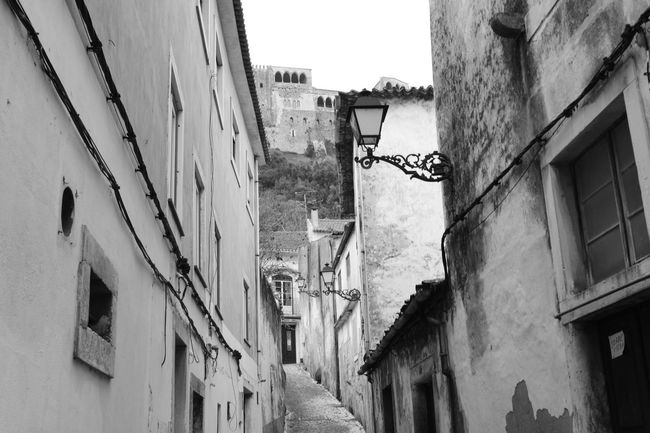 Building Exterior Built Structure Architecture Day Outdoors Low Angle View No People Sky Black And White Noire Et Blanc Preto E Branco Alleway Roadway Passage Road Way Old Buildings Castle Château Castelo Leiria Castle