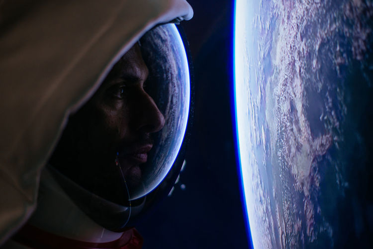 Close-up of astronaut looking at earth from outer space