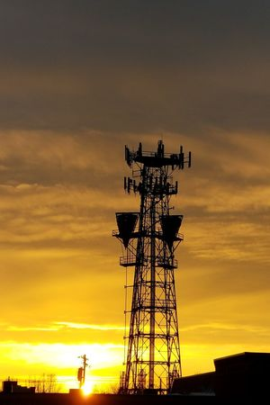 sunset on tech Cell Tower City Sunset Technology Silhouette Business Finance And Industry Sky Architecture Cloud - Sky Building Exterior Tall - High Communications Tower