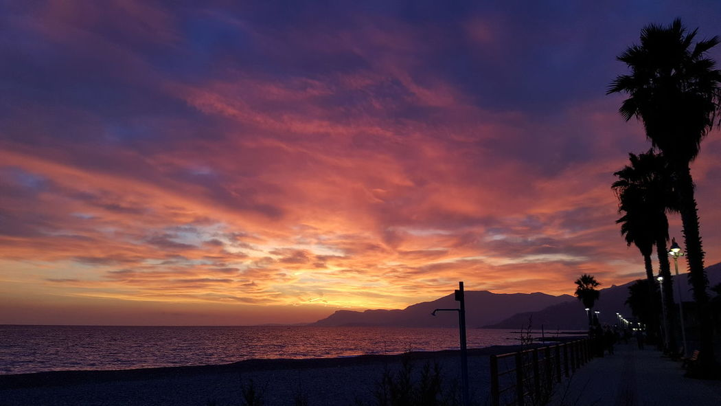 Sunset Sea Cloud - Sky Dramatic Sky Beach Horizon Over Water Beauty In Nature Water Sky Outdoors Nature Vallecrosia Italy