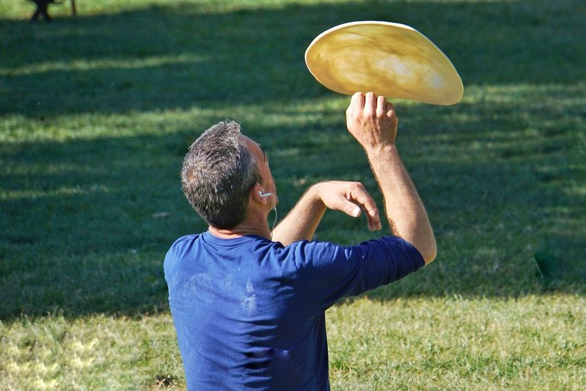 Pizza tossing Mature Adult One Person One Mature Man Only One Man Only Mature Men Sport Rear View Leisure Activity Grass Men Only Men Holding Lifestyles Outdoors Day Adults Only Sports Clothing Adult Real People Sportsman Pizza Toss Pizza Dough Pizza Park BYOPaper!
