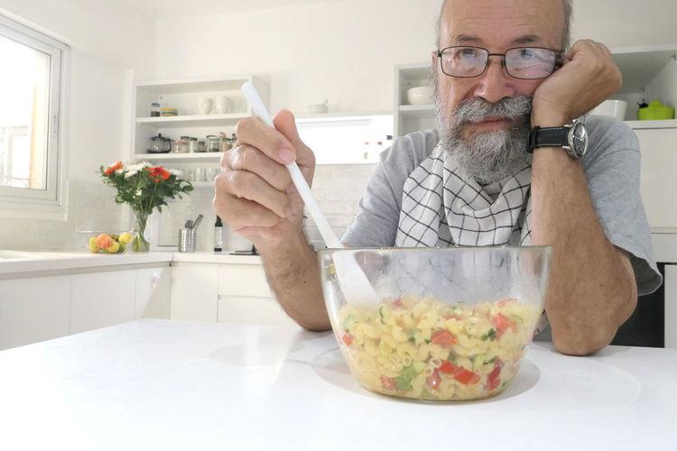 Portrait of man preparing food