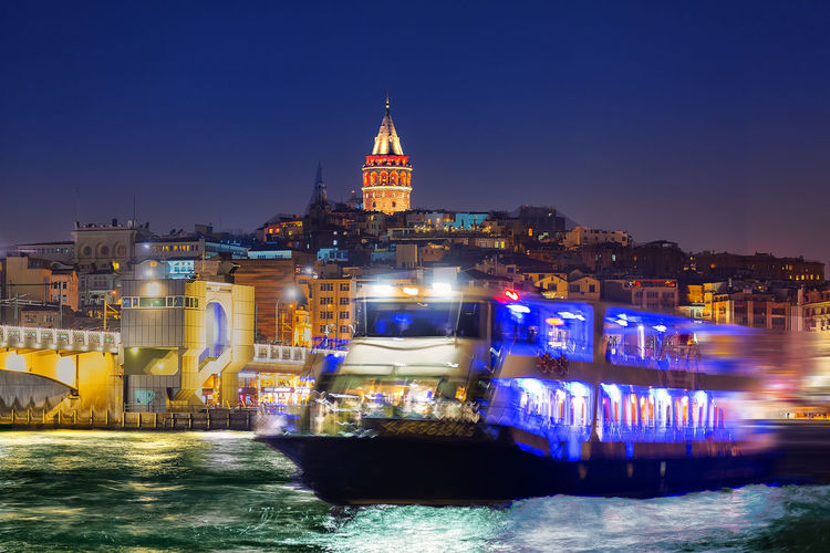 Galata tower and night. Architecture Blue Boat Building Exterior Built Structure City Clear Sky Galary Illuminated Istanbul Turkey Mode Of Transport Nautical Vessel Night Reflection River Sea Sky Tower Transportation Travel Travel Destinations Türkiye Vapur Water Waterfront